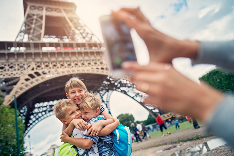 children in front of eiffel tower